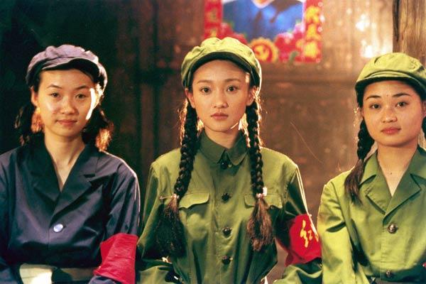 Au centre : Zhou Xun